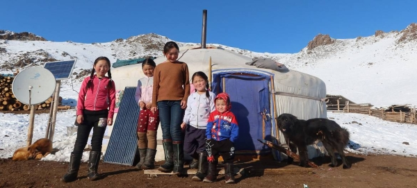 Children from a herding family in rural Mongolia line up outside their yurt in this file courtesy photo.