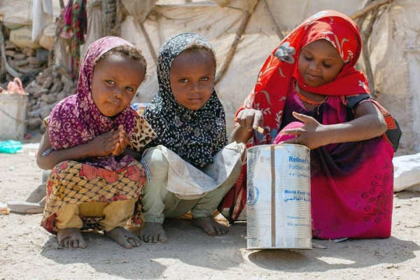 Karima, 7, Bagdhad, 4, Fatooma, 3, play with a WFP oil container. The children and their mother fled to Mokha alone. She said at the time she was so hungry that she ate an onion she found on the ground.