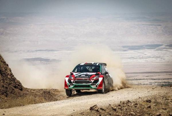 Team technicians prepare Nasser's car in Jordan.