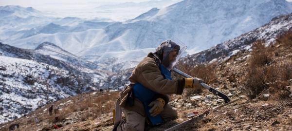An explosives specialist conducts mine clearance operations after detecting a piece of metal in Afghanistan, where 2,300 casualties as a result of landmines were reported in 2017 alone. — Courtesy file photo