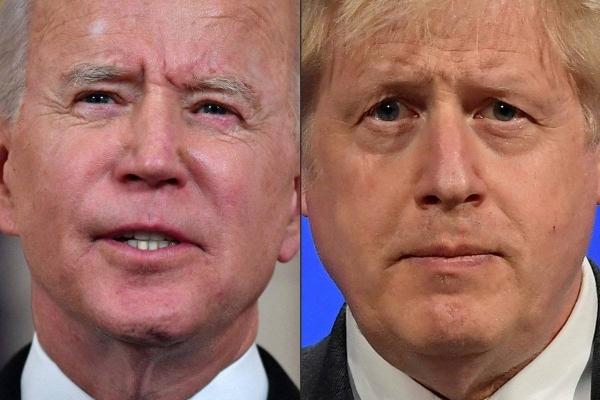 British Prime Minister Boris Johnson, right, and US President Joe Biden are seen in this file combination picture. — Courtesy photo