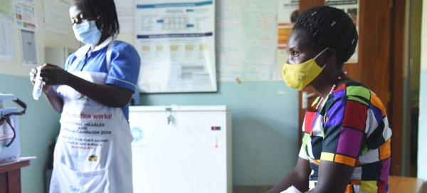 A nurse prepares to administer a COVID-19 vaccination to a patient at a health centre in Kabale, Uganda. — Courtesy photo