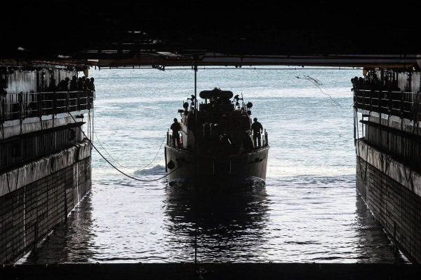 A U.S. Navy Mark VI patrol boat navigates into the well deck of dock landing ship Ashland at Naval Base Guam in this file courtesy photo.