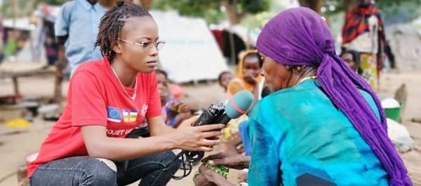 Central African reporter Merveille Noella Mada-Yayoro reporting on conditions at Birao IDP camp. for Guira FM, the UN peace mission's radio in CAR. — courtesy MINUSCA