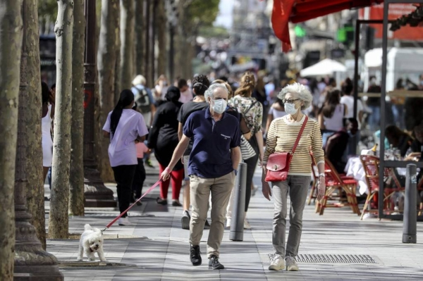 France has lifted the requirement to wear a face mask outdoors in public and will stop its nighttime curfews earlier than planned. — Courtesy file photo