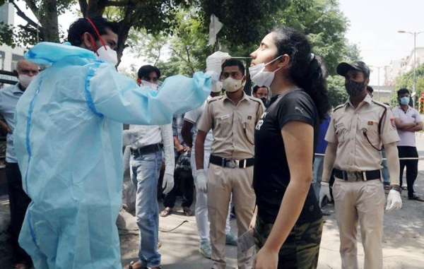 India reported 58,419 new COVID-19 infections over the past 24 hours on Sunday, the lowest daily number in nearly three months, data from the Health Ministry showed.