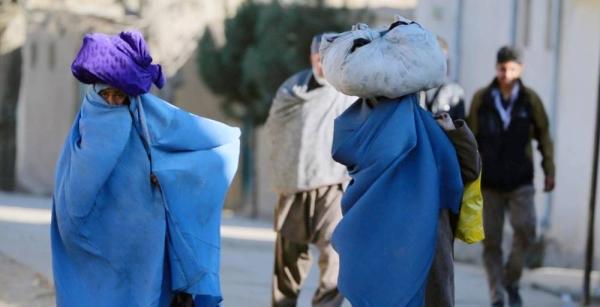 Women carry bundles through a neighborhood of Kabul, the capital of Afghanistan. — courtesy World Bank/Ghullam Abbas Farzami