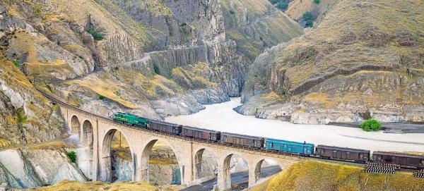 A locomotive freight train traverses the Absirom Bridge on the Trans-Iranian Railway in Iran. — courtesy UNESCO/Hossein Javadi