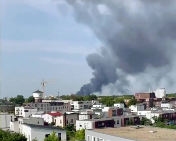 A videograb shows smoke billowing following an explosion at a chemical park in the German city of Leverkusen on Tuesday.