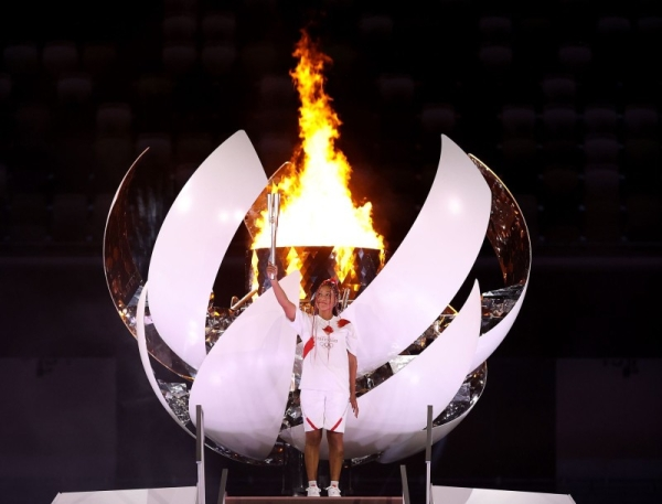 Naomi Osaka of Team Japan lights the Olympic cauldron with the Olympic torch during the Opening Ceremony of the Tokyo 2020 Olympic Games at Olympic Stadium on July 23. (Credit: twitter @naomiosaka)