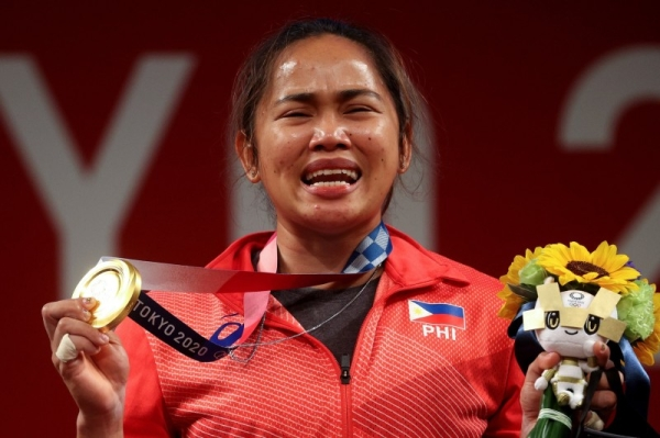 Diaz burst into tears and embraced her coaches after completing the record-breaking lift. (Credit: Twitter @Olympics)