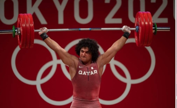 23-year-old Ibrahim won the gold medal in the 96kg category at the Tokyo games lifting a total weight of 402kg, which is an Olympic record. — QNA