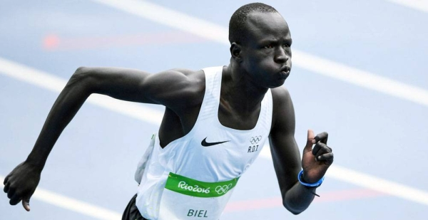 South Sudanese refugee, Yiech Pur Biel, runs the 800-meters for the Refugee Olympic Team in Rio. (August 2016) — courtesy UNHCR/Benjamin Loyseau