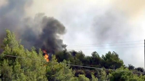 An aerial photo shows wildfires in Kacarlar village near the Mediterranean coastal town of Manavgat, Antalya, Turkey, Saturday.