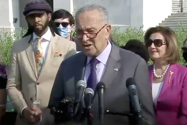 Senate Democratic leader Chuck Schumer makes a point on the $1 trillion infrastructure bill.
