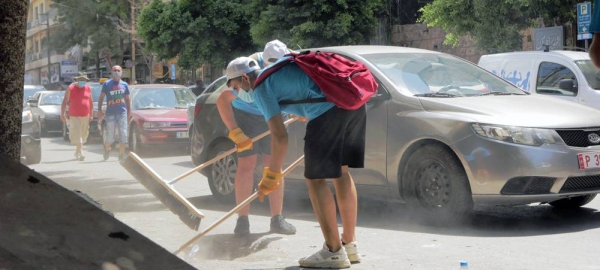 UNICEF youth network volunteers clean up Mar Mikhael after the port explosions. — courtesy UNICEF/Toya Masri