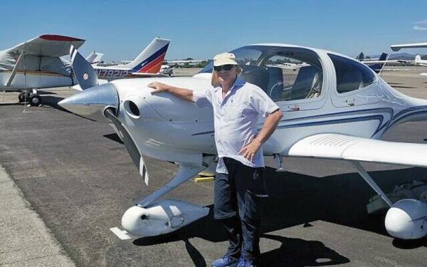 Haim Geron stands next to a light plane. — courtesy Facebook