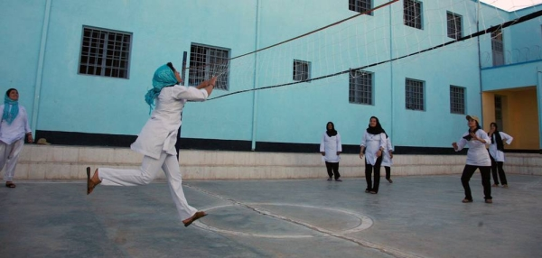 Girls play volleyball at a school in Herat, Afghanistan, in 2016. — courtesy UNAMA