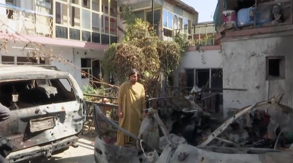 An Afghan inspects the damage of Ahmadi family house in Kabul, Afghanistan after the Aug, 28 drone strike.
