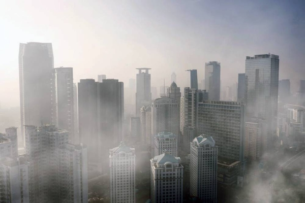 File photo of an aerial view of severe air pollution with skyscrapers in Jakarta city on April 24, 2019. — courtesy photo
