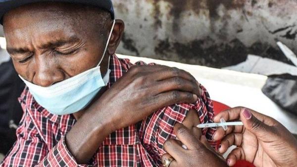Man getting vaccinated in Kenya.