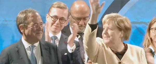 Angela Merkel, whose party is scrambling to avoid defeat by its center-left rivals after a rollercoaster campaign, is seen with Armin Laschet, left, during hectic last-minute campaigning.