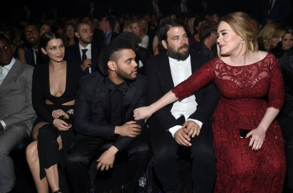 Adele (R) and her ex-husband, charity entrepreneur Simon Konecki (2R) attend The 58th GRAMMY Awards at Staples Center in Los Angeles, California. — File photo