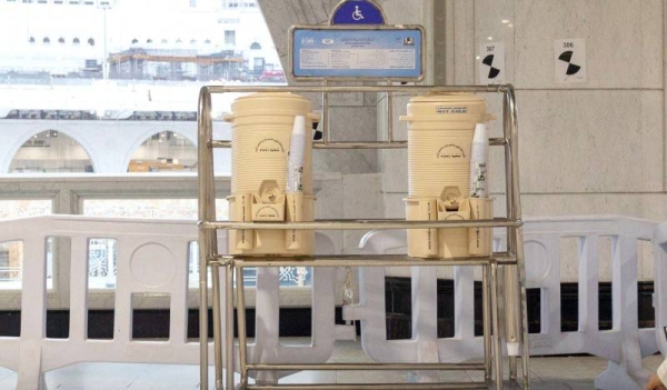 Zamzam water containers at fixed marble stations return to Grand Mosque in Makkah