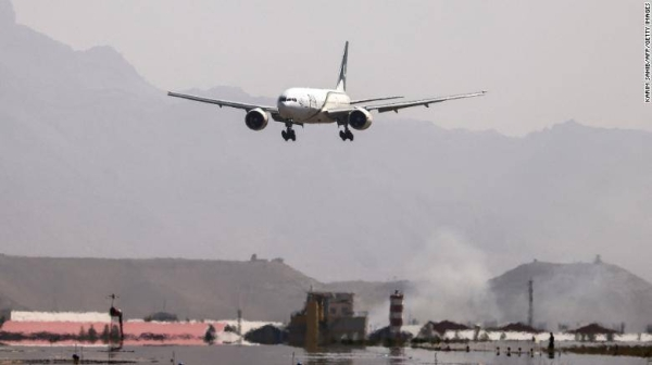 A Pakistan International Airlines plane lands at Kabul airport on September 13.